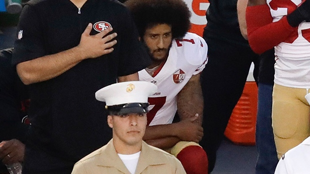 San Francisco 49ers quarterback Colin Kaepernick kneeling during the national anthem.